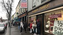 A long queue forms before the start of a half-price sale at Funge's Gorey
