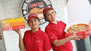 In-store team members Neeyati Vaghela and Luciana Matos mark the announcement that Apache Pizza is to open 20 new stores, including plans to open one or more stores in Wexford. Photo: Julien Behal Photography