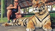 John during a visit to a wildlife sanctuary in Thailand.