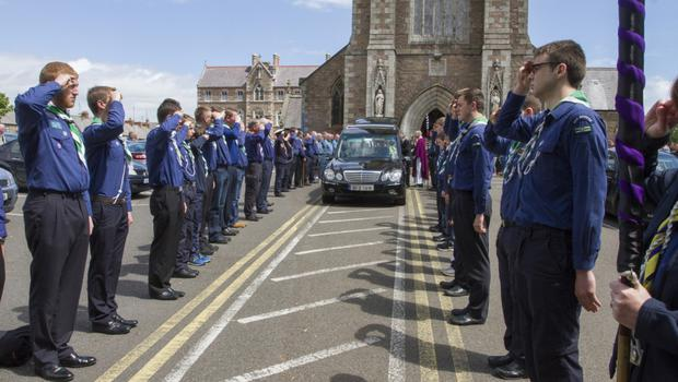 A final salute from the scouts for Joe as he leaves Bride Street Church for his final resting place in Crosstown.