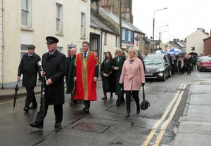 Mayor Ger Carthy and other local councillors at the front of the funeral procession as it makes its way along John Street.