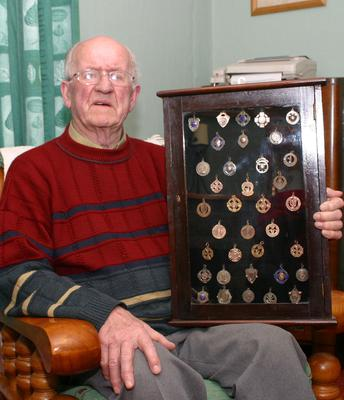Paddy Kehoe Charleton Hill displaying a selection of medals he won during his football career