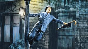 What a glorious feeling: Gene Kelly in the iconic scene from Singin' in the Rain (Sunday, BBC2, 2.35pm)