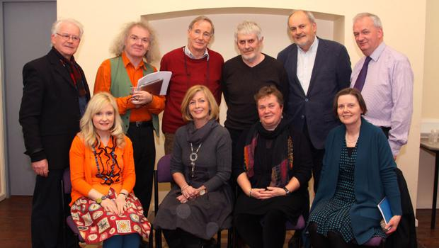 At the readings were, front, Caroline Busher, Maria Clifford, Helen Gaynor and Betty Thompson.  Back: Donal Moore, Denis Collins, Sean Clarkin, Mogue Doyle, Larry Stapleston and librarian Jarlath Glynn.