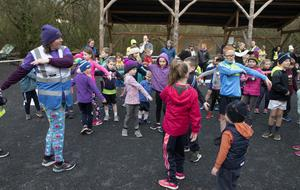 Neomie Van Der Blaike put the children through their warm-up exercises before the start of the Junior Park Run in the Irish National Heritage Park