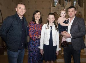 Caroreigh NS pupil Kara Delaney on the occasion of her Confirmation in Caroreigh Church, with Joe Colman, Sarah Delaney, Katelyn Delaney and Paddy Delaney.