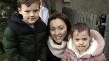 James, Audrey and Eve Carroll enjoying a visit to the live crib in the Friary