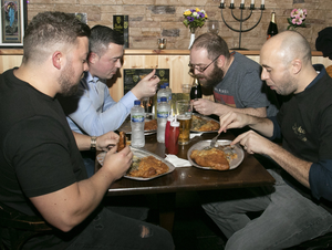 Tom Wise, Willie O'Reilly, Kenneth Hore and Chris Penrose taking part in the pastie eating challenge at the official opening of Juke Bakery and Café Commercial Quay
