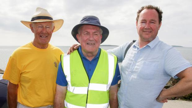 Peter Hussey, Willie Roche and John Rossiter taking part in the Lions Club coastal walk in Kilmore Quay.