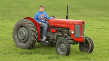 Looking back - Jack Waters taking part in a vintage tractor run at Templar's Inn in July 2013