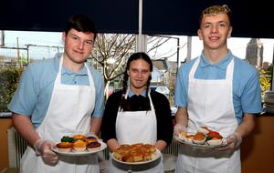 Our Lady of Fatima School students Mick Sheehan, Gemma O'Brien and Brian Power helping out at the cake sale in aid of Age Action Ireland on Friday morning in the school.