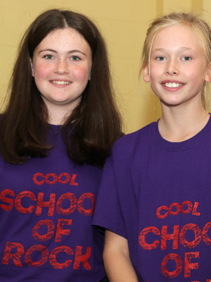 Isabella Caulfield and Keeva Molony who were the lead singers in the group Not So Supergrass at the Cool School of Rock Music Generation show in Scoil Mhuire Coolcotts.