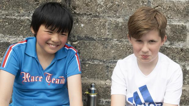 Jack Zhong and Denas Grigorjevas taking a break at the sports day in the Mercy School, St John's Road