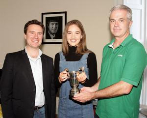 Aisling Gouldson (violin), winner of the Alan Cutts Cup for her rendition of Allegro form Concerto in A Minor by Vivaldi, is presented with her trophy by school principal David Creevy and school director Karl Richards.