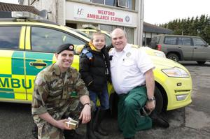 Logan with rescuers Cpl Stan Holloway and paramedic Declan Cunningham