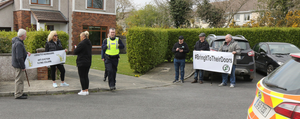 Protesters and gardaí outside the home of Minister Paul Kehoe