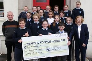 Mercy School sixth class pupils with teacher Paul King presenting a cheque for €1,422 to Margaret McDonnell for Wexford Hospice Homecare