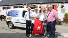 George Golea is presented with his prize of a Family Trip to Lapland at his business in Castlebridge. L/r; Tomás Scallan (Scallans), George Golea, Colm Conneely (Kepak) and James Brady (Scallans).