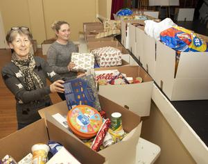 Lillian Crowley and Nicola Mangan of the St. Vincent de Paul Society with Christmas food hampers at St. Michael's Hall in Green Street