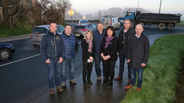Cllr Frank Staples (far right) with local business people concerned at the traffic problems at Sinnottstown Lane. From left: Brendan McCleane (Tool Hire), Peadar O'Brien (The Cooney Grain Company), Rita Kinsella (Meadows and Byrne), Billy Devereux (Farmers Kitchen), Vera Casey (Meadows and Byrne), and Sean Hearne (Eishtec)