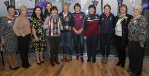 Soroptimists members with members of the St Martin's camogie team: Phil Lynch, Alma Hynes, Eadaoin Lawlor, Ciara O'Connor, Kitt Codd, Susie Maddock, Maire O'Connor, Barbara Ryan, Tracey Browne, Michelle Winters and Barbara Harrison