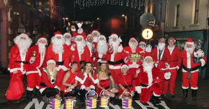 The Santas who embarked on a festive pub crawl in aid of the MS Society in memory of the late Sean Rossiter.