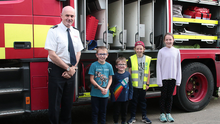 Chief fire officer Ray Murphy with Sebastian, Gus, Connie and Pippa Morris