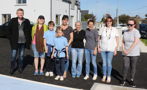 Some of Slippery Green residents who received the keys of their new houses on Friday