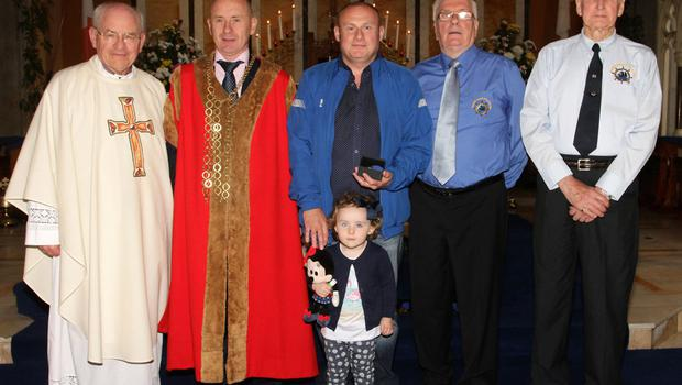 Medal recipient Declan Roche for James Roche with Fr Michael O'Shea, Cllr Frank Staples, Mayor of Wexford; Padge Reck and Jack Higginbotham, Friends of the Tall Ships.  Also pictured is Kenzie Roche.