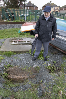 Cllr David Hynes at the site where raw sewage is spewing from the ground in Maudlintown.