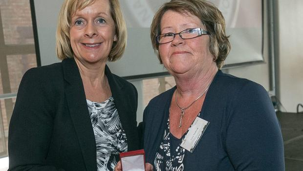 Lucy Radford receives the Gold Badge on behalf of her husband Sean from Kilmore Quay Station branch.