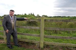 Mayor George Lawlor beside the site.