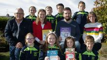 Aidan Doyle, Chairperson of the Parents Council at Castlebridge NS, presents Weaving Wellbeing books to the student council. Aidan is pictured with Ed Lyons (principal), teachers Amanda Bolger and Annmarie Hearne, and members of the student council. Goalposts were also presented to the school