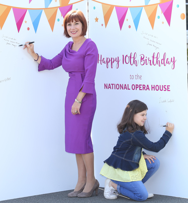 August 2018: Young Wexford singer, Lucy Caulfield helped Minister for Culture, Josepha Madigan sign a giant birthday card to mark the 10th birthday of the Opera House. The card will be placed in the foyer for incoming artists to sign