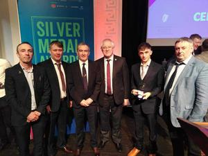 Jake Shannon, second from right, having received his award