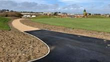 One of the paths in the nearly completed Min Ryan Park