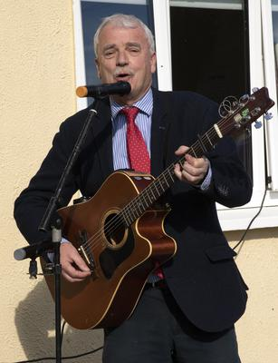 Minister Finian McGrath sings a song for the attendance.