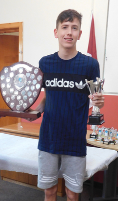 Swimmer of the Year, Stuart Vaughan, with his award