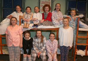 The orphans on stage in 'Annie' in Oylegate Community Centre.