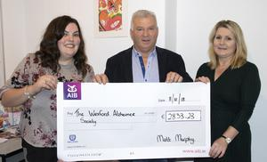 Matt Murphy presents the cheque to Katie Smith and Samantha Whelan of the Alzheimer Society.