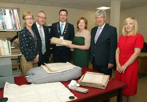 At the Wexford County Archive in Ardcavan Business Park Irish Distillers hand over archives from Powers Distillery (from left): Grainne Doran (Archivist, Wexford County Council), John Ryan (Irish Distillers), Cllr Michael Sheehan (Chairman, Wexford County Council), Carol Quinn (Archivist, Irish Distillers), John Kearney (Director of Services, Wexford County Council) and Eileen Morrissey (County Librarian).