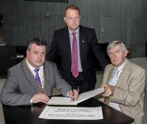 Mayor George Lawlor, Cllr Tony Dempsey, chairman, Wexford County Council , and Tom Enright, county manager, open  a book of condolence at County Buildigns in memory of the students who died.