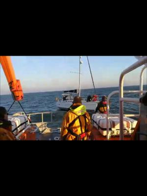 Rosslare lifeboat with the yacht under tow.
