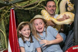 Pictured are James Hennessy, Director and creator of the Reptile Village with nine year olds, Katelyn Hennessy (9) and Aisling Dwan well as Rascal the Burmese python.
