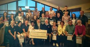 Wexford community groups presenting cheque for €7000 raised during festival to Wexford RNLI.