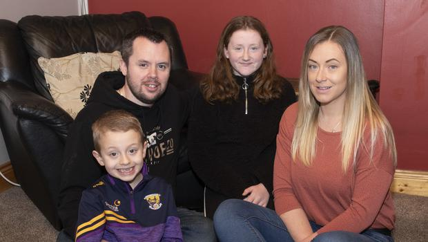 Tommy Kinsella (7) with his parents Gary and Nóirín and sister Katelyn