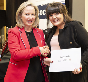 Kacey Maher receives her AIB Business Student of the Year Award at WIT from Noelle Chambers, Student Officer at AIB