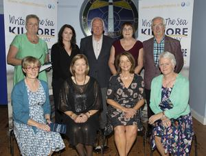 The Write By The Sea Festival committee, from left, back – Elena Winch, Laura McGlynn, John Moran, Theresa Burke and Derek Burke; seated – Jean Cullinane, Lucy Moore (chairperson), Sylvia Kehoe and Mary Byrne