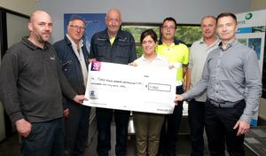 Kent Stainless staff John Walsh, Damien Donovan, Tony Byrne, Niall Ellard, Dermot Richards and Sean Kent presenting a cheque for €1,150 to Sinead Kehoe of Pieta House
