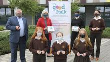 Loreto Wexford TY Mini Company presentation of 3D Printed trolley tokens to It's Good 2 Talk. Back: John Forde, Madeline Quirke and Jenna Murphy (It's Good 2 Talk) and Shauna Cullen. Front: Siobhan Rossiter, Ciara Rees and Jessica Ruane.